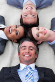 Manager and his team lying on the floor — Stock Photo