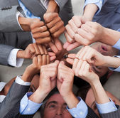 Multi-ethnic business with thumbs up — Stock Photo
