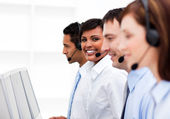 Customer service agents in a call center — Stock Photo