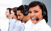 Attractive young woman working in a call center — Stock Photo