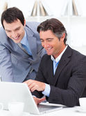 Two assertive colleagues working at a computer — Stock Photo