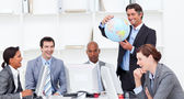 A meeting of a lucky business team about globalization — Stock Photo