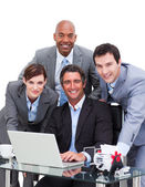 Ambitious business team working at a computer — Stock Photo