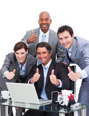 Enthusiastic business team with thumbs up — Stock Photo