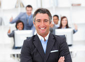 Presentation of a positive manager and his team — Stock Photo
