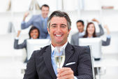 Prosperous manager and his team drinking champagne — Stock Photo