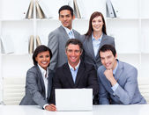 Successful business team looking at a laptop — Stock Photo