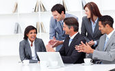 Laughing businesswoman applauded by her team — Stock Photo