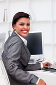 Attractive female executive working at a compute — Stock Photo