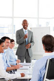Confident Afro-American businessman discussing with his team — Stock Photo