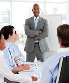 Confident manager reporting sales figures to his team — Stock Photo