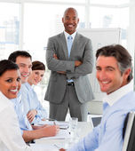 Afro-american businessman giving a presentation to his team — Stock Photo