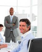 Businessmen in a meeting with their team — Stock Photo