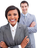 Beautiful businesswoman posing in front of her colleague — Stock Photo