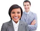 Radiant businesswoman posing in front of her colleague — Stock Photo