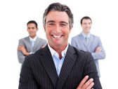 Enthusiastic businessman posing in front of his team — Stock Photo