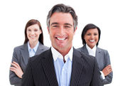 Self-assured businessman posing in front of his team — Stock Photo