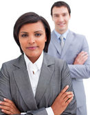 Ethnic businesswoman posing in front of her colleague — Stock Photo