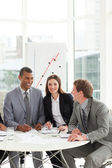 International co-workers sitting at a conference table — Stock Photo