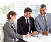 Attractive young businessman smiling at the camera in a meeting — Stock Photo