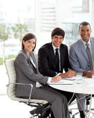 Three co-workers smiling at the camera — Stock Photo