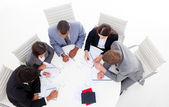 High angle of a diverse business group sitting around a conferen — Stock Photo
