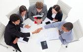 Successful international business shaking hands — Stock Photo