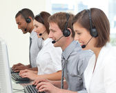 Concentrated customer service agents working in a call center — Stock Photo