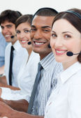 Customer service agents smiling at the camera — Stock Photo