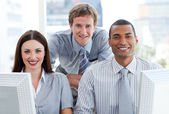Ambitious business group working at a computer — Stock Photo