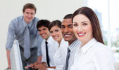 Cheerful business team working at computer — Stock Photo