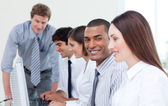 Enthusiastic business team working at computer — Stock Photo