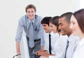 Self-assured manager and his team — Stock Photo