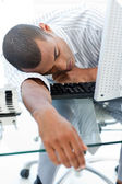 Tired businessman sleeping on his desk — Stock Photo