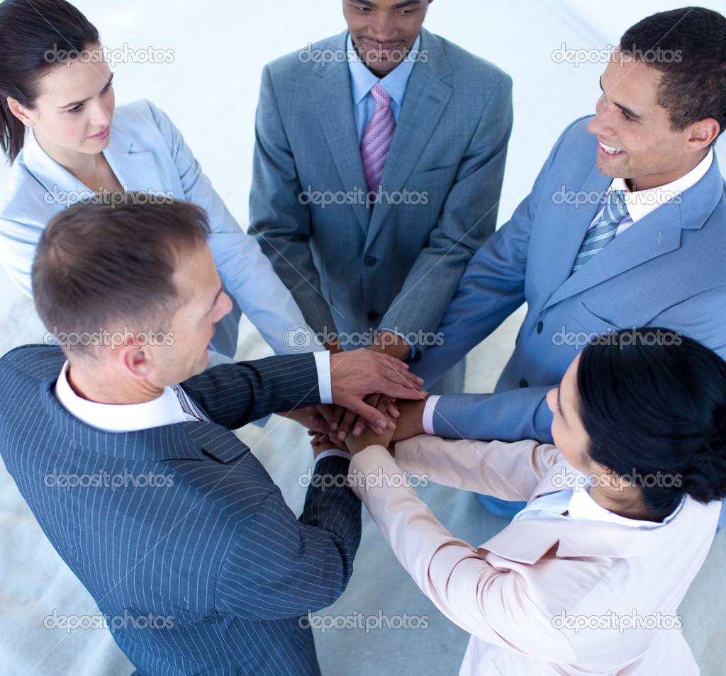 High angle of multi-ethnic business team with hands together — Stock Photo #10280093