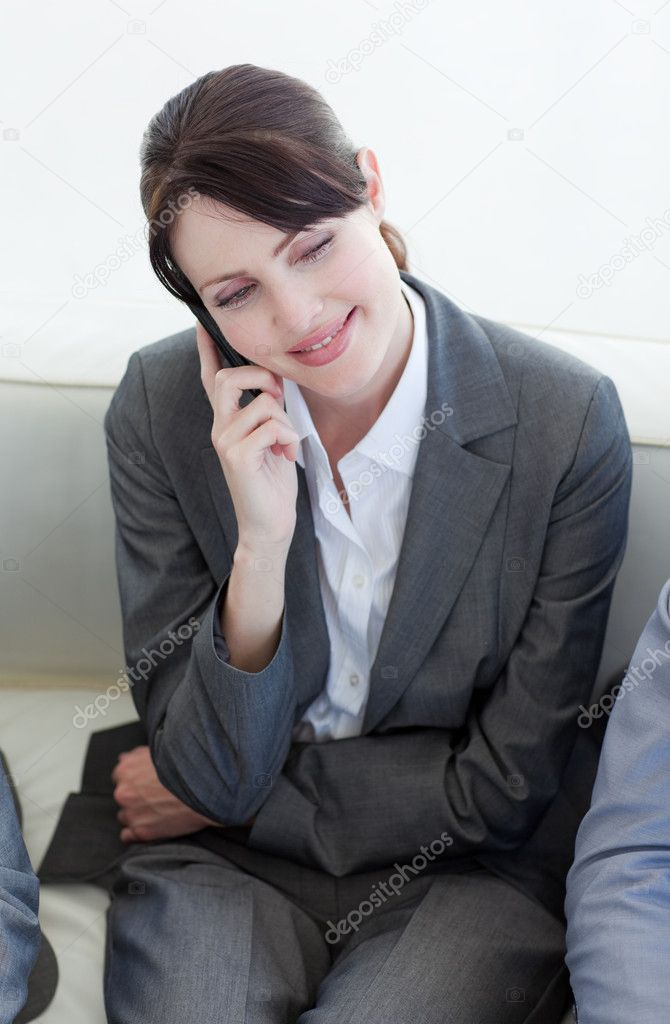 Smiling businesswoman on phone while waiting for a job interview in an office — Stock Photo #10281074
