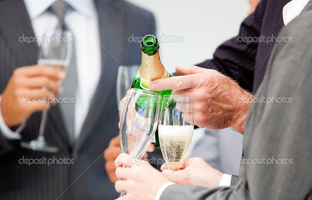 Close-up of a businessman serving Champagne in the office — Stock Photo #10281408