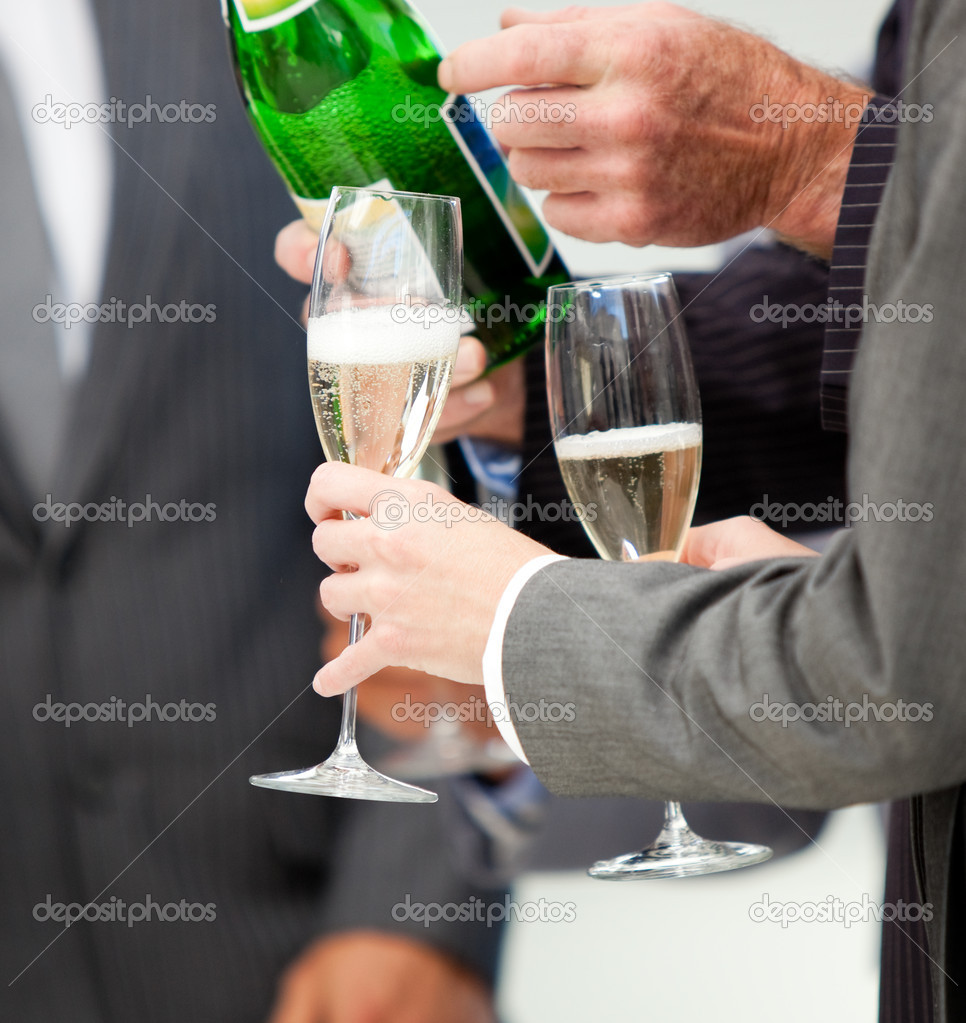 Close-up of a business person serving Champagne in the office — Stock Photo #10281409