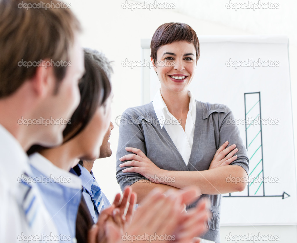Cheerful business applauding a good presentation in the office  Stock Photo #10281959