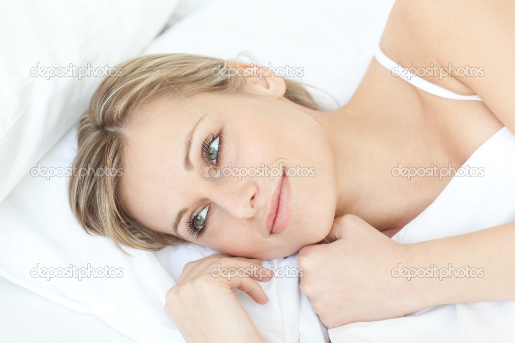 Smiling relaxed woman lying on her bed at home — Stock Photo #10282654