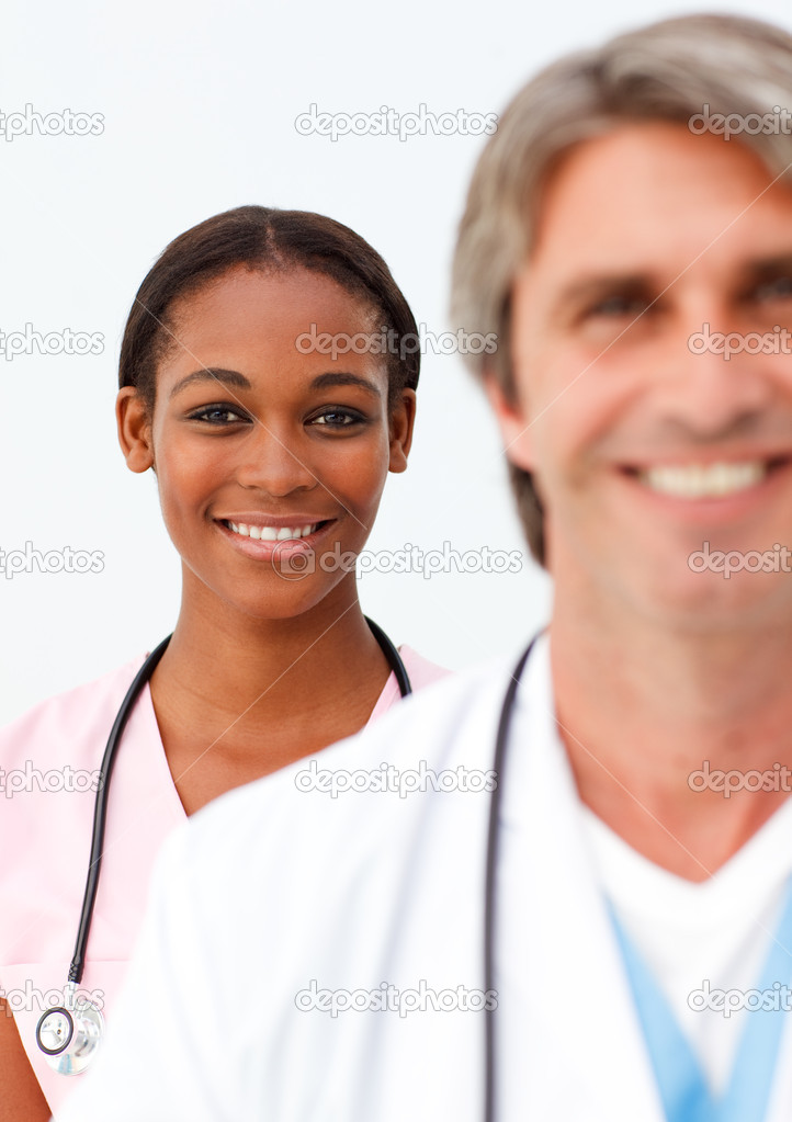 Portrait of two positive doctors against a white background  Stock Photo #10282750