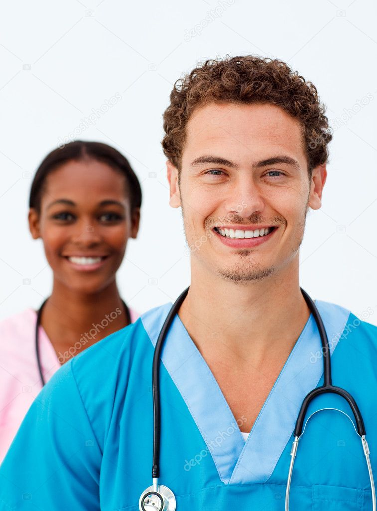 Portrait of two positive doctors against a white background — Lizenzfreies Foto #10282753