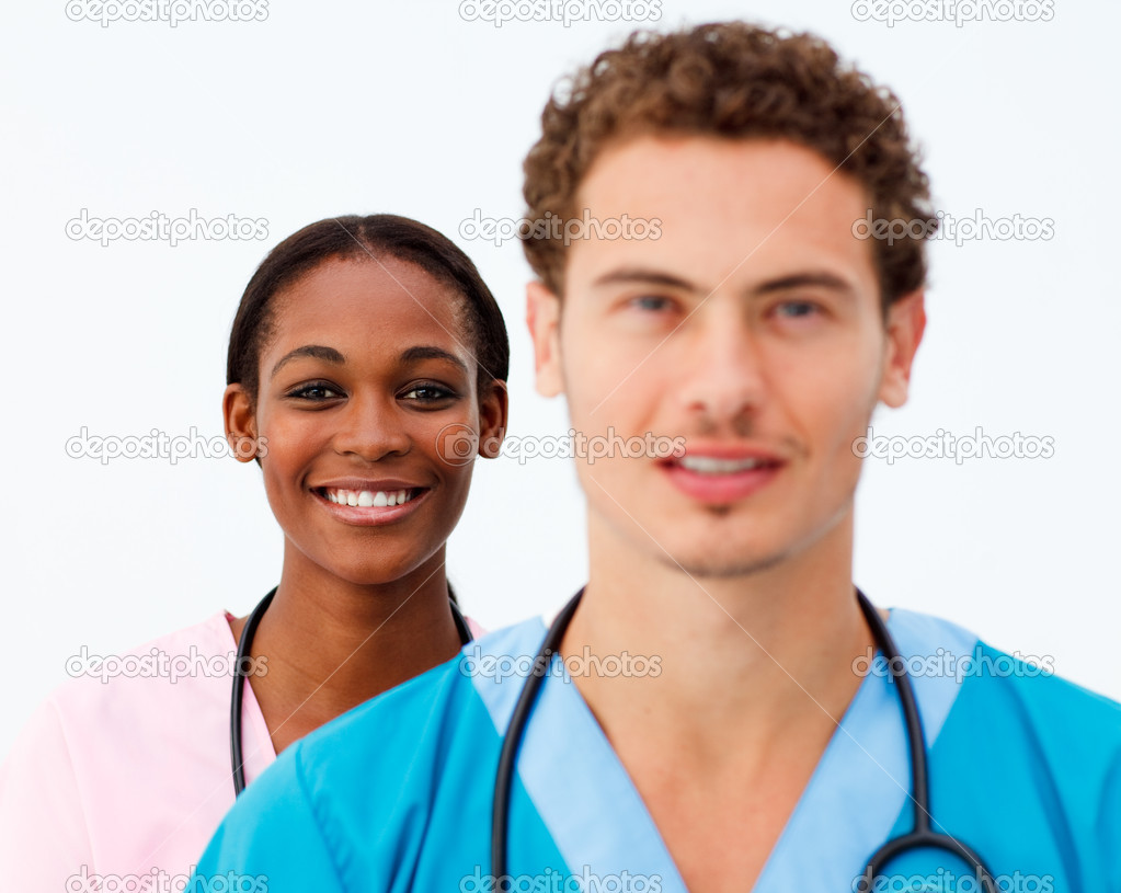 Portrait of two positive doctors against a white background  — Lizenzfreies Foto #10282755