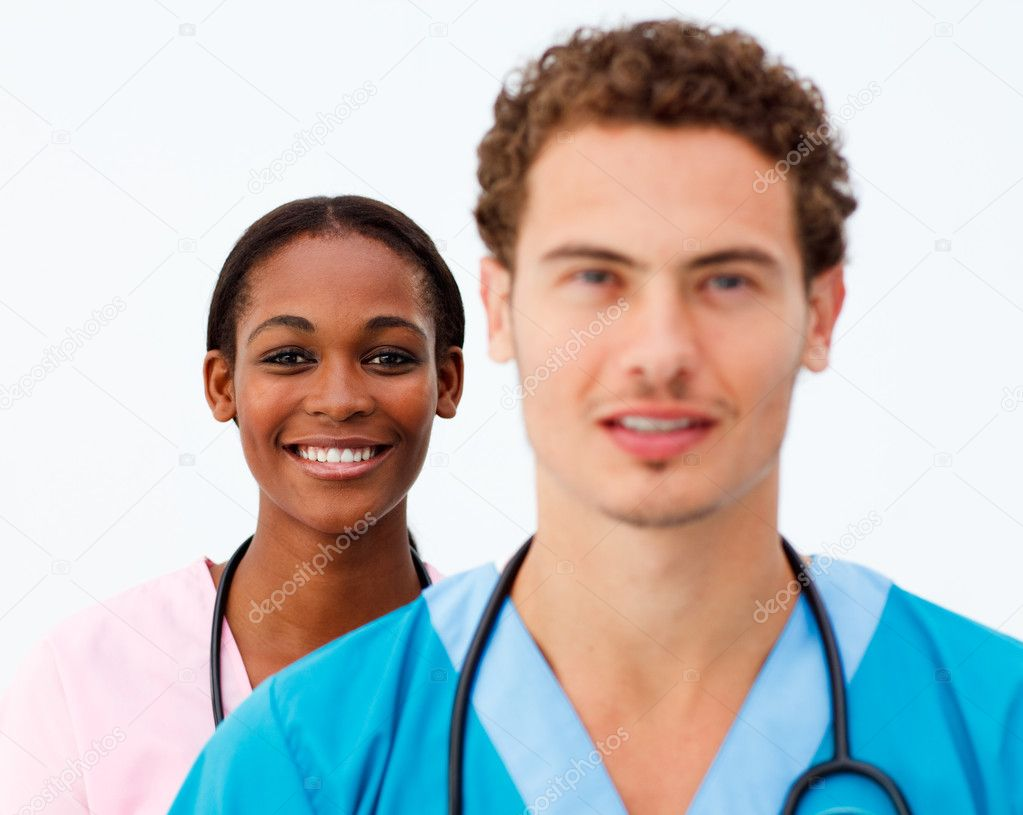 Portrait of two positive doctors against a white background   Stock Photo #10282755