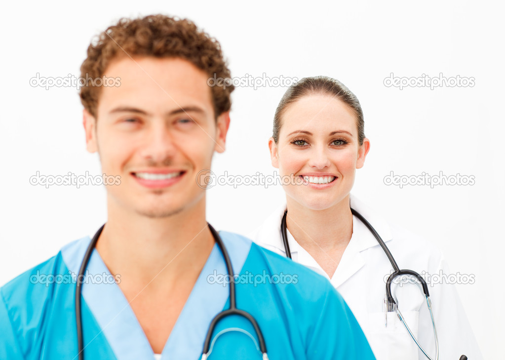Portrait of two positive doctors against a white background  — Lizenzfreies Foto #10282758