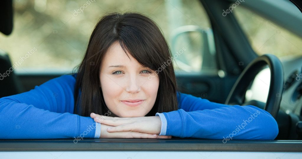 depositphotos 10283762 Cute teen girl smiling at the camera sitting in her car Cute teen girl smiling at the camera sitting in her car outdoor