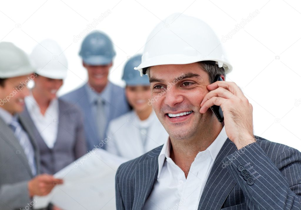 Mature male architect on phone standing in front of his team — Stock Photo #10285101