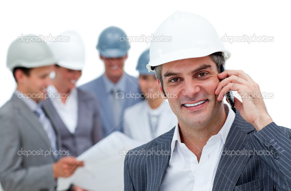 Smiling male architect on phone standing in front of his team — Stock Photo #10285105