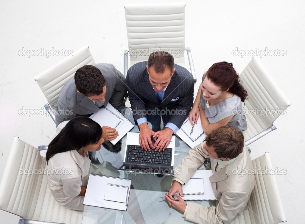 High angle of business team working together with a laptop in an office — Stock Photo #10285279