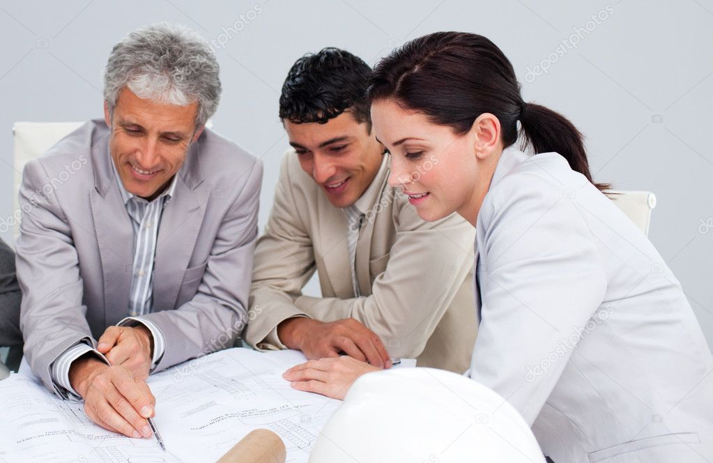 Portrait of architects studying plans in a meeting  Stock Photo #10286537